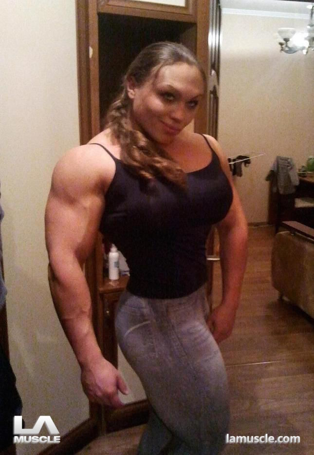 image Sexy muscle woman dominates