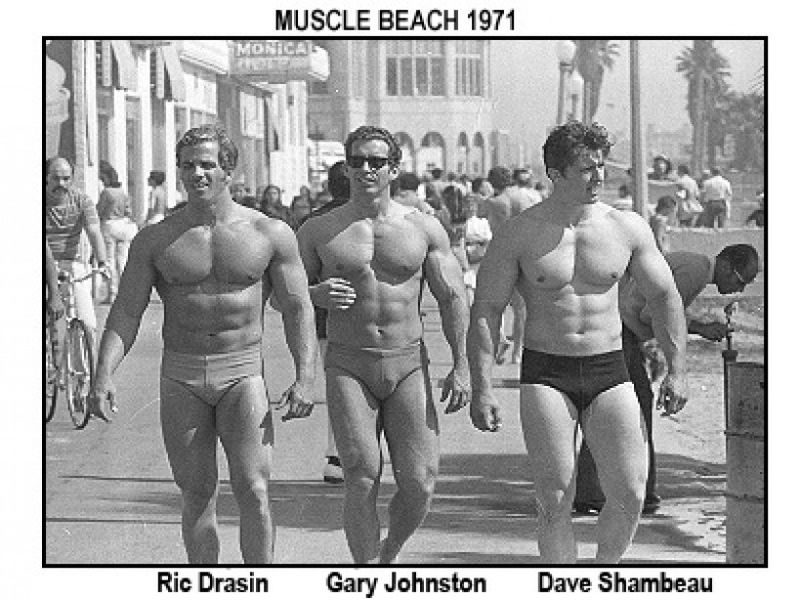 Bodybuilders on beach